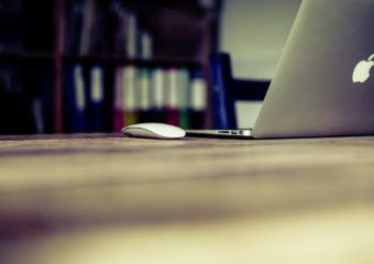 laptop-and-computer-mouse-on-table-in-library
